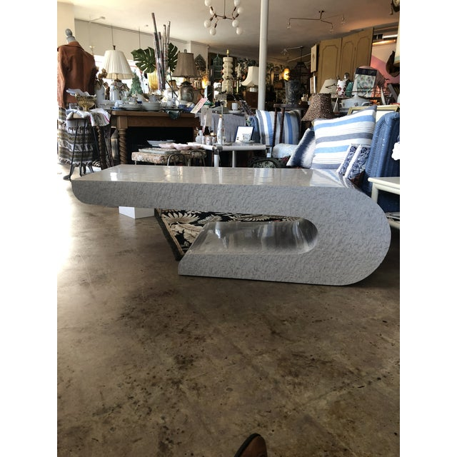 Unique sculptural coffee table in the Karl Springer Style. Gray in color with faux burl wood pattern.