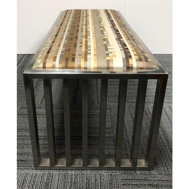 Mid-century Modern museum bench in brushed chrome with a timeless investment with Maharam textile. Looks great in any...