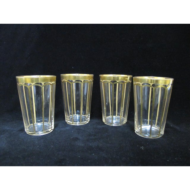 """Beautiful vintage glassware set of 4 tumbler each in clear glass with gold gilt. Each measures 3 3/4"""" tall x 2 3/8 mouth...."""