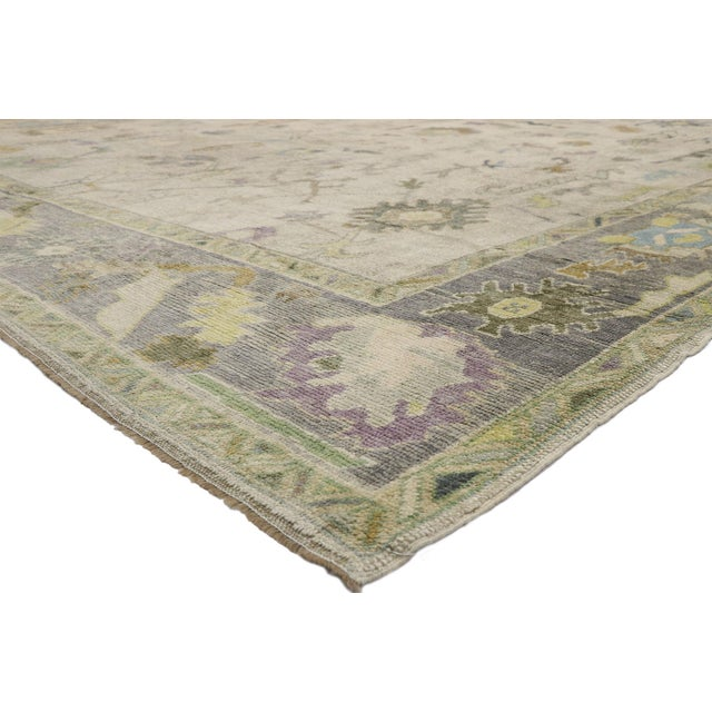 52535 Contemporary Turkish Oushak Rug with Pastel Colors and French Transitional Style 12'05 x 17'01. Highly stylish yet...