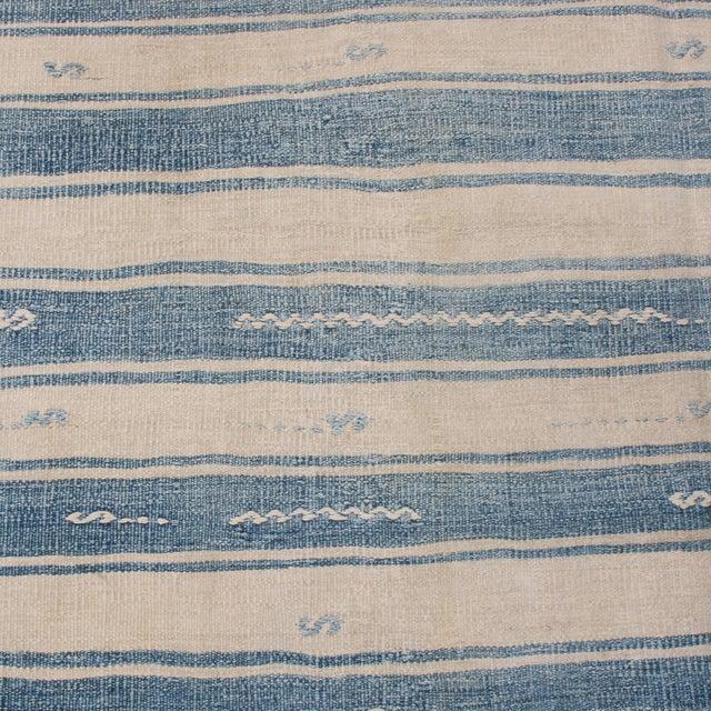 Flat woven in high-quality wool originating from Turkey between 1940-1950, this vintage Malatya Kilim rug enjoys an...