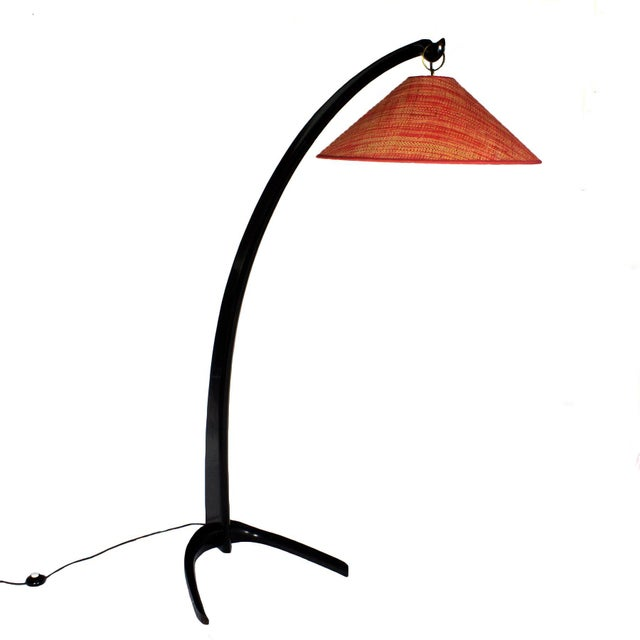 Arched standing lamp, stained solid mahogany, French polish. New rusty red raffia lampshade. Italy, circa 1950.