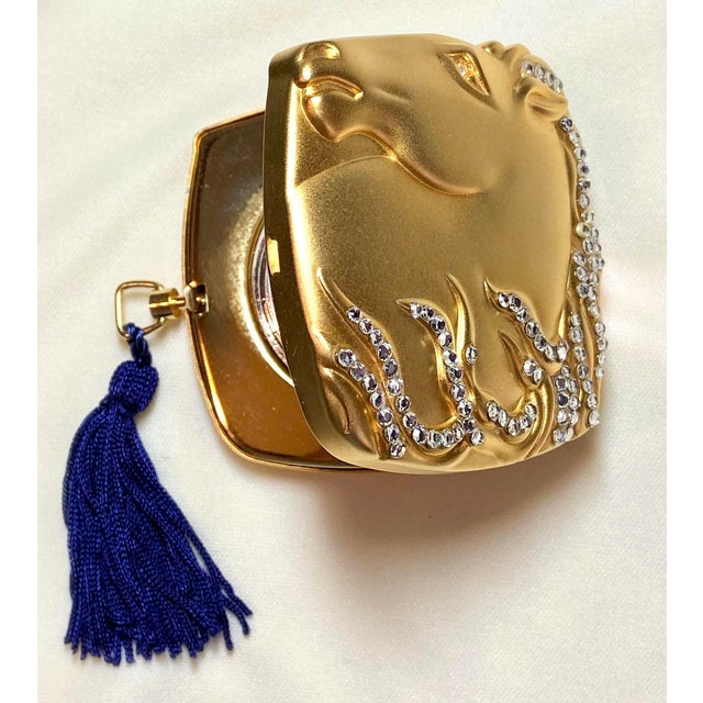 Glamorous accessory, 2001 Estee Lauder Year of the Horse jeweled powder compact. Decorative and dazzling gold metal...