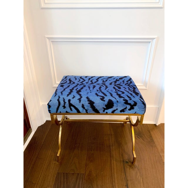 Gilded stools covered in Scalamandre's iconic silk velvet Le Tigre fabric.