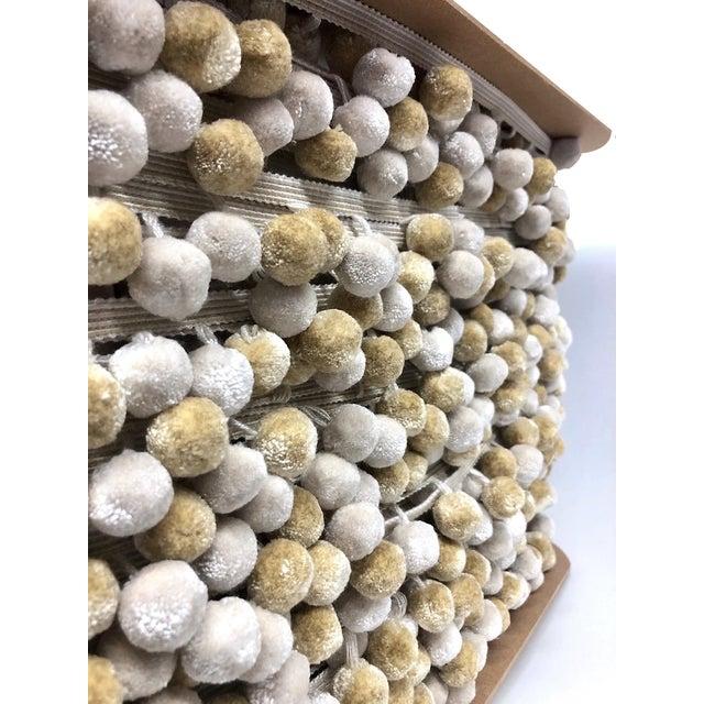 6.75 running yards of alternating (color) pompom tassel fringe in cream and beige. Decorative header has 5 color ombré and...