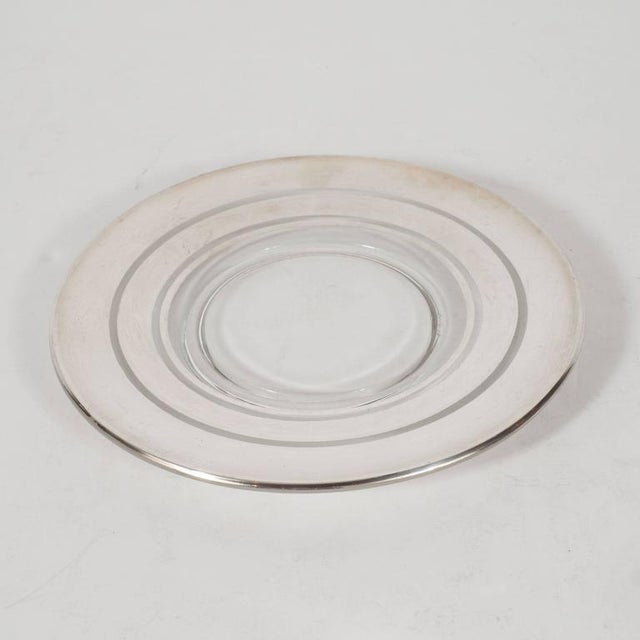 This elegant set of six Art Deco silver overlaid hors d'oeuvres plates were created by the legendary designer Dorothy...