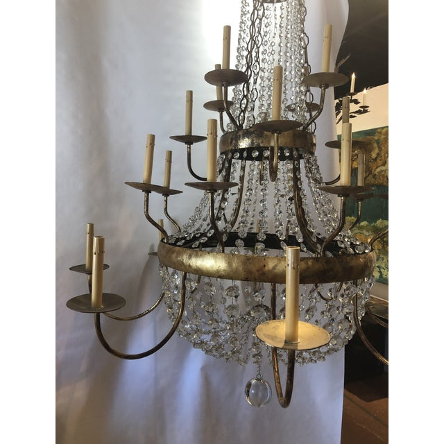 Stunning vintage French gilt and crystal chandelier. Chandelier has twenty four-light sources. The timeless elegance of...