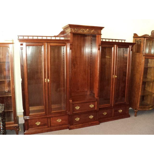 Beautiful cherry bookcase, circa 1900, in excellent restored condition! It is a three section unit, having two glass doors...