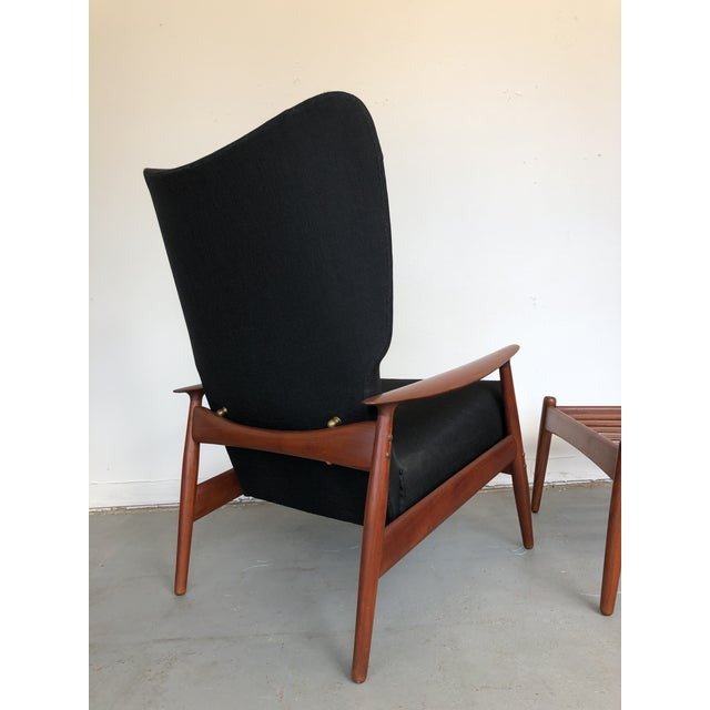 A stellar example of danish craftsmanship. Solid brass joinery hardware, beautifully aged teak, bold wingback style, bowed...
