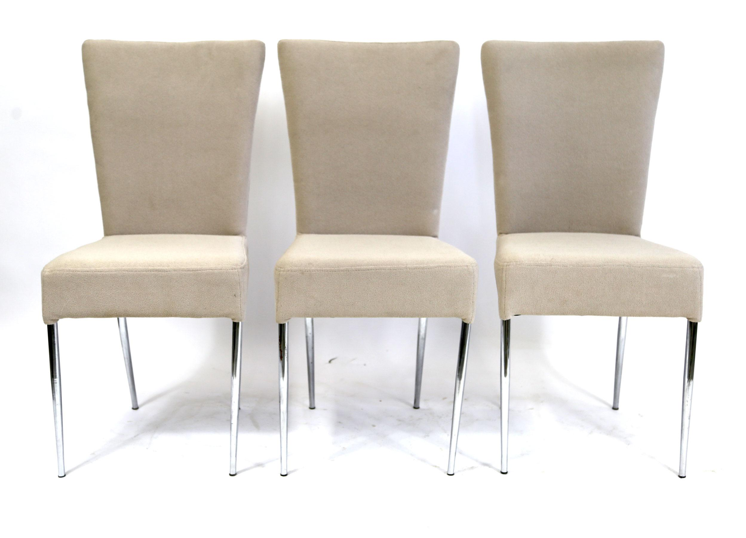 A Set Of Three Chairs With A Pleasing Greyish Brown Fabric Upholstery And  Chrome Legs.