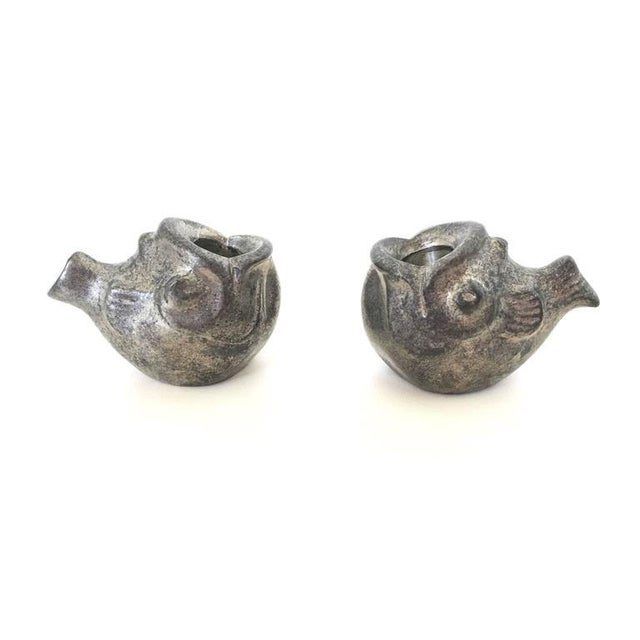An adorable pair of small fish with open mouths by Just Andersen meant to hold thin candles. Made of pewter and signed on...