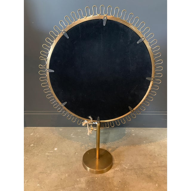 A gorgeous sunburst standing mirror in a warm brass finish. The standing feature makes it perfect for a bathroom or wash...