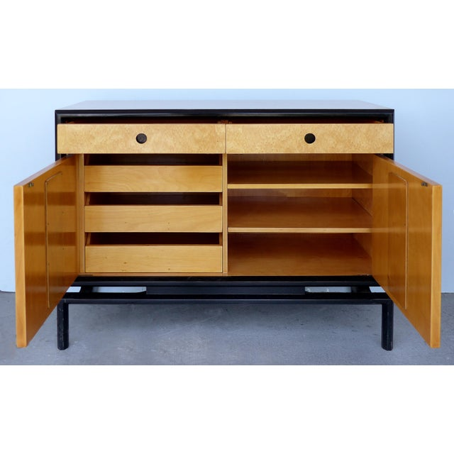 Offered for sale is a pair of bird's eye maple cabinets by Swedish cabinet maker Edmund Spence. Each cabinet has two doors...