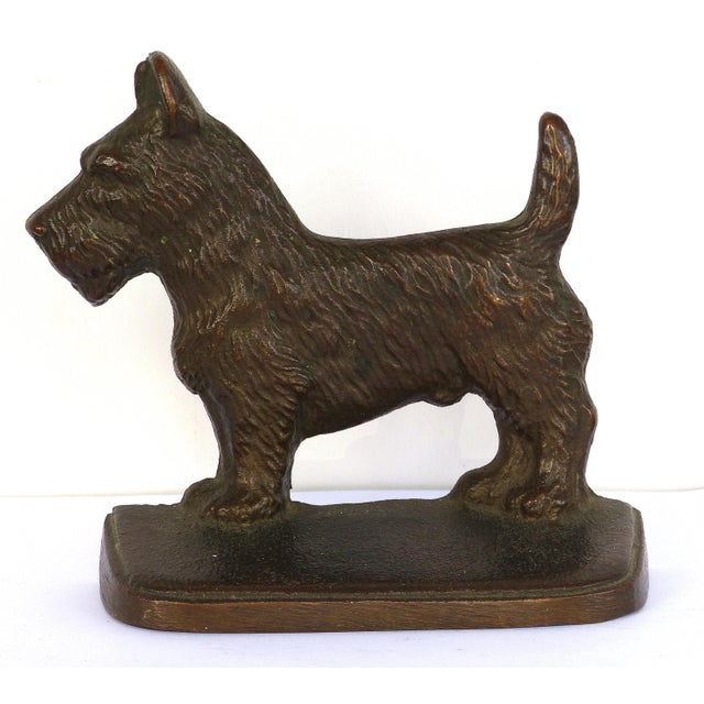 """Vintage cast iron """"Scottie"""" dog bookends, a pair . Offered for sale is a pair of cast iron bookends in the shape of..."""