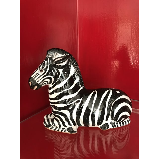 We've all seen the large Italian glazed animals, but this is a small version zebra perfect for a desk or table top.