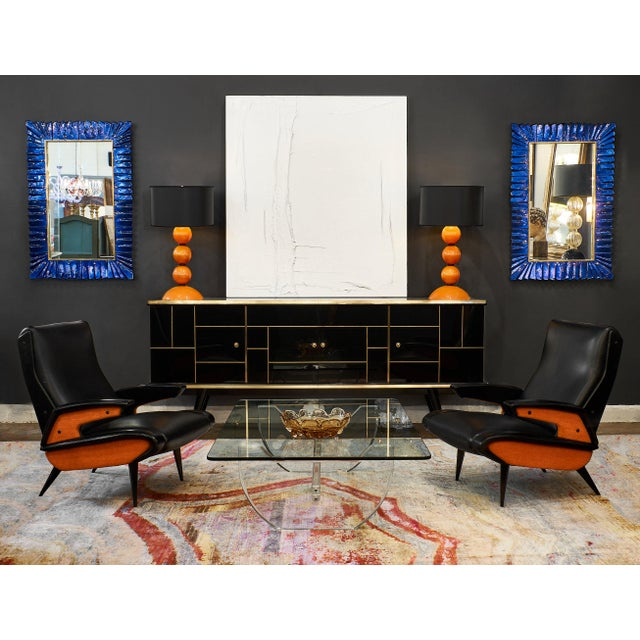 French modernist Lucite coffee table. This is a bold, dramatic, and ultra modern piece with a thick glass slab top. The...