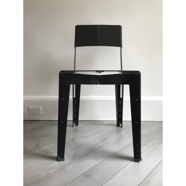Aluminum Folding Chair, manufactured completely with laser cut aluminum plate in black polished lacquer, by Australian...