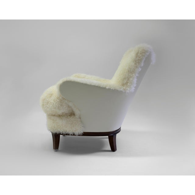 The Willow club chair is a whimsical chair that can be used in any room - shown covered in shearling with button detail on...