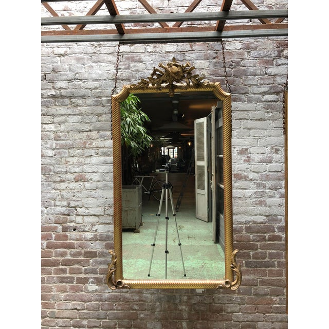 19th century mirror, gold leaf gilded in the style of Louis XVI, Provenance France This ribbed profiled mirror frame is...