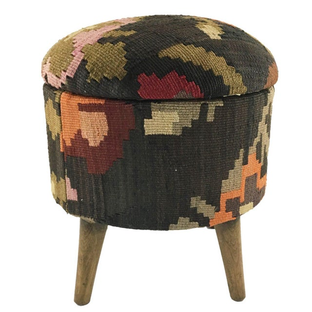 What could be better than a one-of-a-kind kilim pouf you ask? We know! A kilim ottoman with built-in storage! Check out...