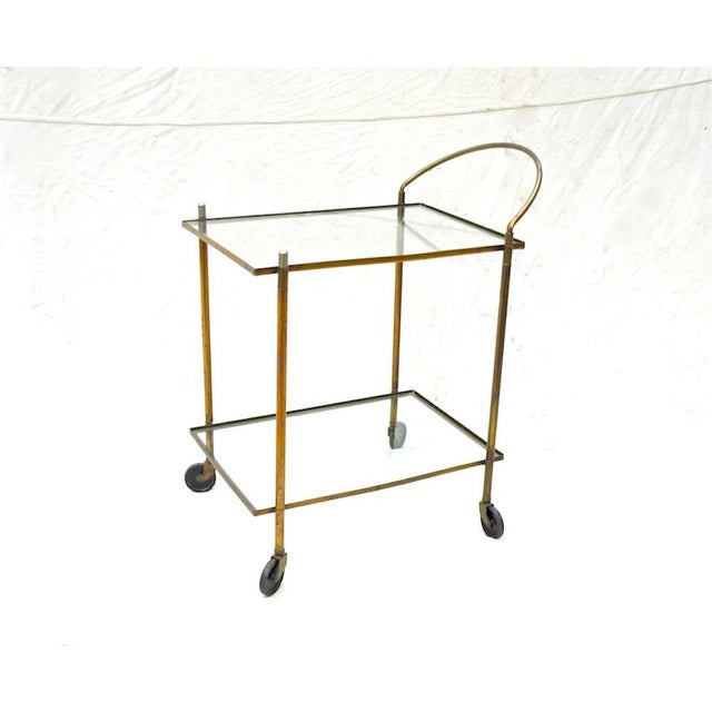 A vintage brass and copper bar cart of simple form and design. Not complicated, not fussy. Ideal for covered porch or...