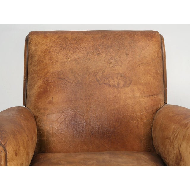 French Art Deco leather club chair, that our in house upholstery department has carefully disassembled and rebuilt as...
