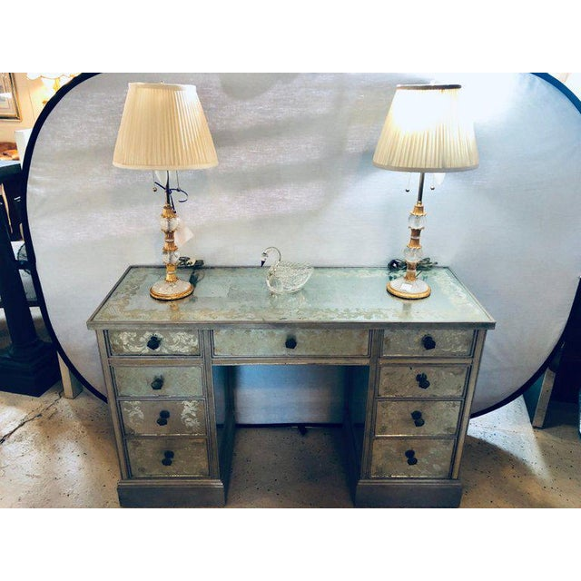 Art Deco Era mirrored reversed paint decorated églomisé desk or vanity. This stunning antiques glass and mirrored vanity...