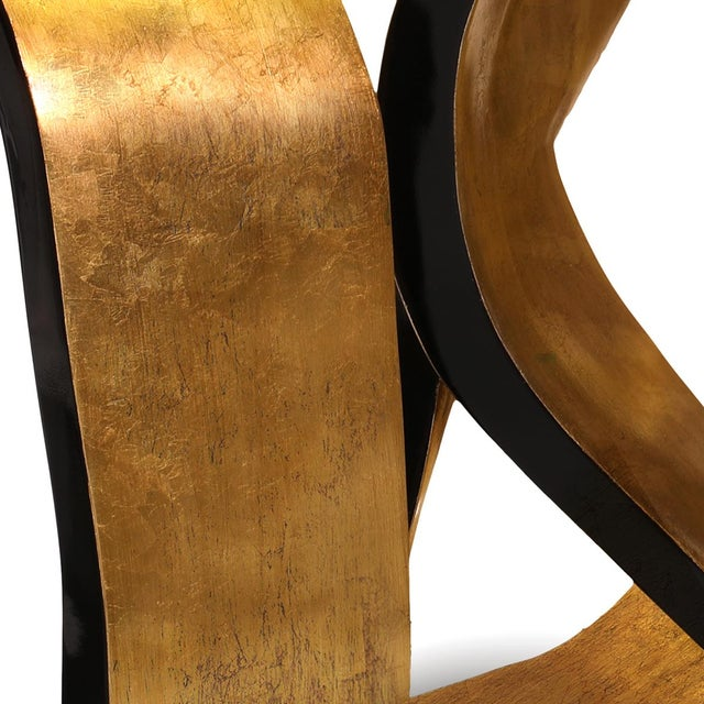 Get wrapped up in the rhythmic design of the Ribbon dining table. The provocative twists and turns of the base are...