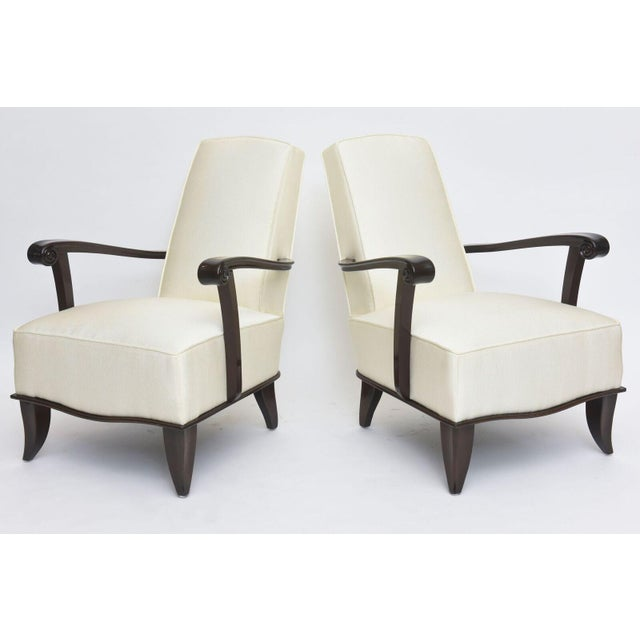 This pair of French modern rosewood and upholstered armchairs by Jean Pascaud made in the 1940s reflects Pascuad's...