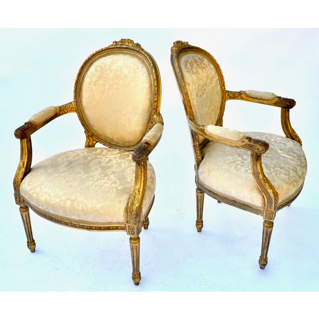 Lovely pair of French 19th-20th-C Louis XVI style chairs, upholstered in silk, old time worn original gilt patina,...