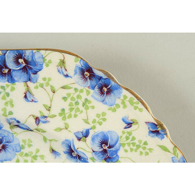 Lord Nelson English Chintz Pansy Square Plate features blue pansy flowers with green leaves. Visible crazing based on age...