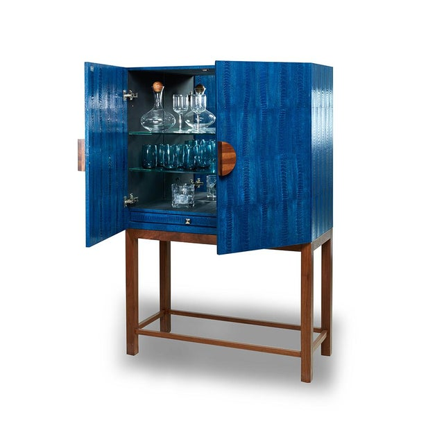Bar Cabinet in Ripple Blue. Interior mirrors and glass shelving. Natural walnut base and handle. Brand new and custom made.