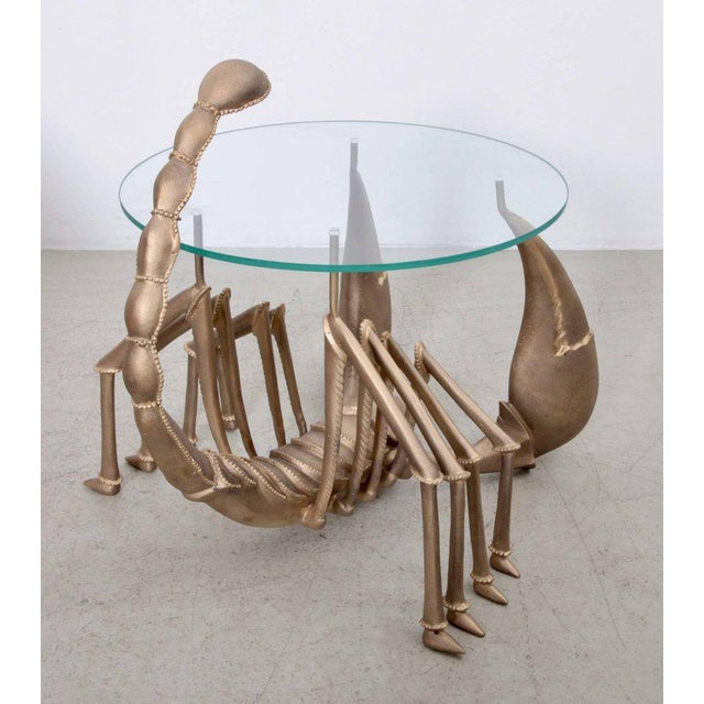 Very rare brass coffee or side table attributed to Jacques Duval-Brasseur in the 1970s. The table is made of brass and has...