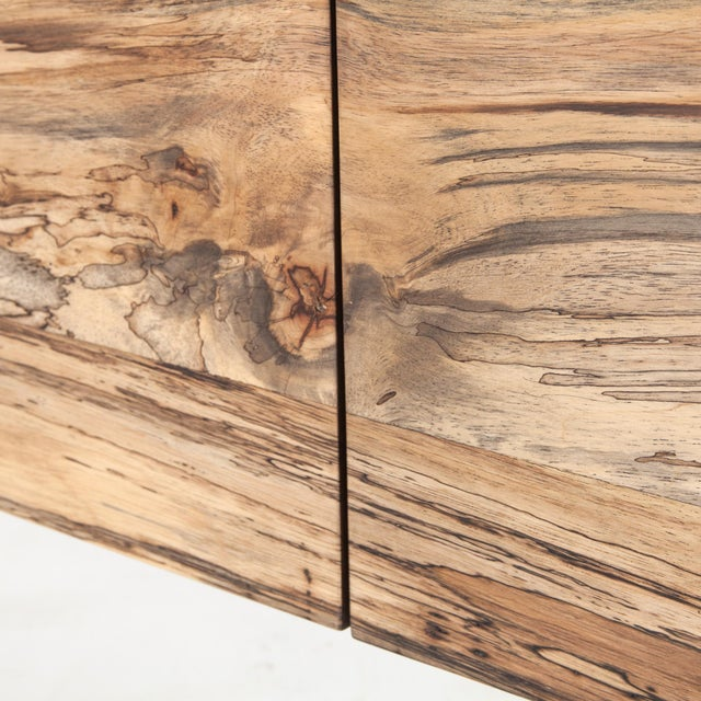 Highs and lows capture movement in this high impact sideboard. Spalted primavera is supported by a contrasting frame of...