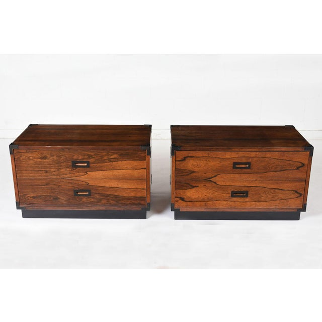 This pair of 1960's Campaign-style chest of drawers is made of rosewood stained a rich rosewood color with a lacquered...