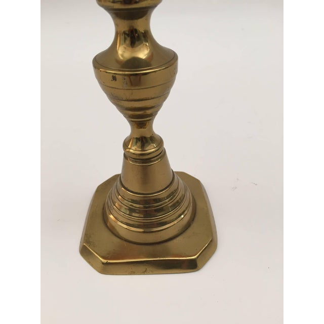 """Pair of tall English brass candlesticks with push up. Size: 10""""5 x 4"""". Great brass decorative art objects."""