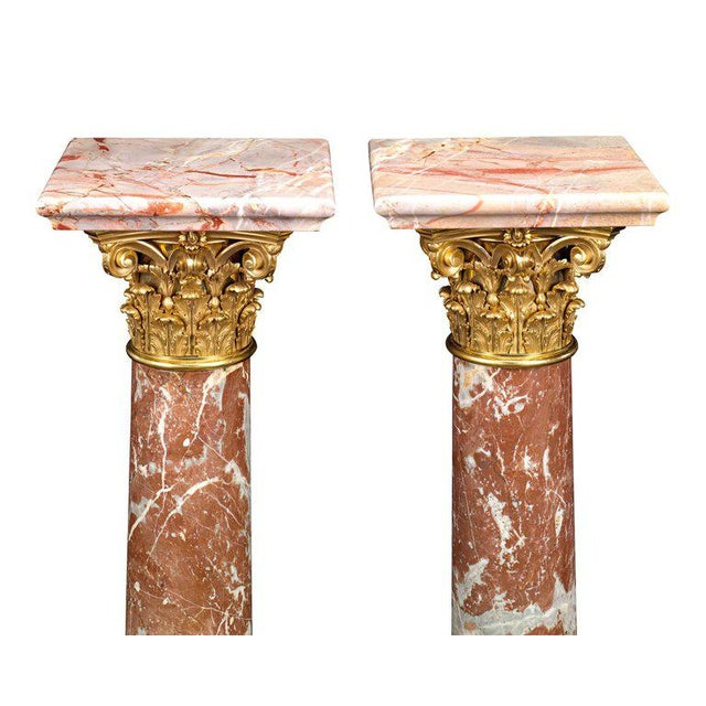 Four complementary varieties of marble were selected to create this stately pair of French Louis XVI-style pedestals....