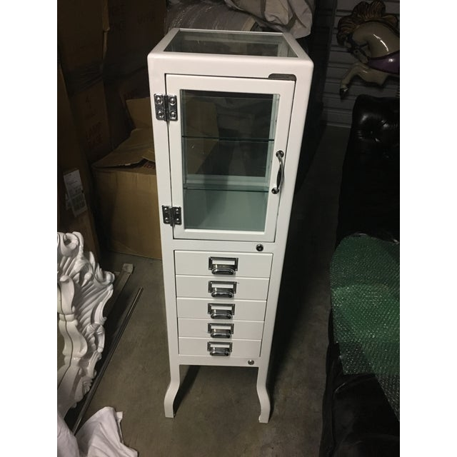 Like new, very well cared for Restoration Hardware bath pharmacy style cabinet in a beautiful white with five drawers and...