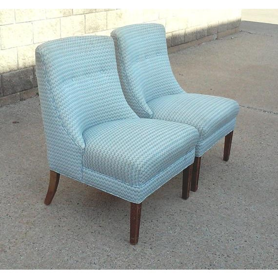 A pair of Regency armless slipper chairs with great lines and very comfortable. Both chairs are well made, heavy and...