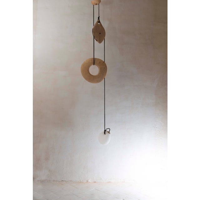 Dimensions: 150 x 30 x 20 cm. Edition: Unique. Title: Poulie. Composition: Blown glass, beech, metal. Lighting by the...