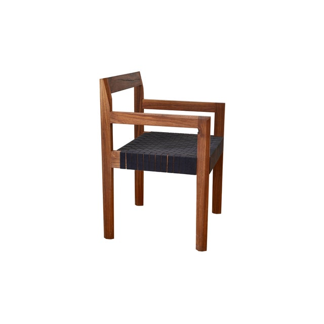 The faceted dining chair by Casey McCafferty, shown in oil rubbed black walnut with a modern black shaker tape, is perfect...