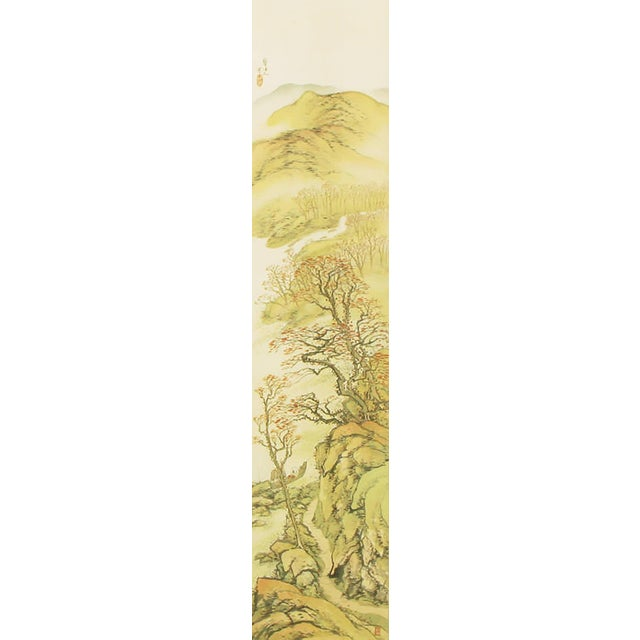 Nearly 6 feet tall Japanses water color painting of a mountain scene at spring time. Bordered in an embroidered silk and...