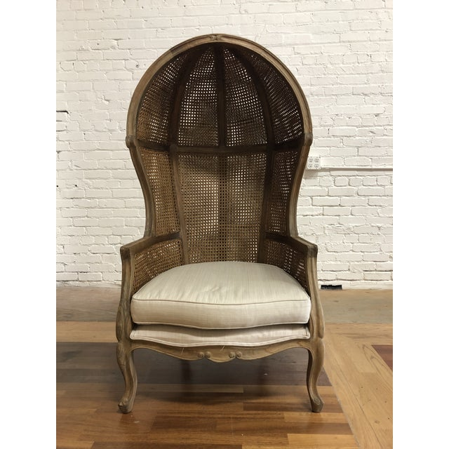 Design Plus Gallery presents a Porter Style Balloon Chair. A beautifully wood carved framed. Features a vintage style...