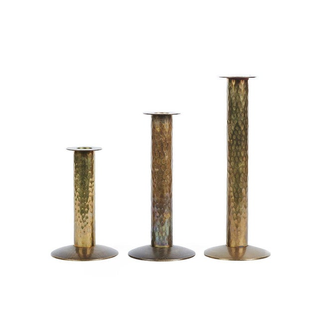 Set of 3 vintage hammered brass table top candlesticks. They would compliment any interior from traditional to mid-century...