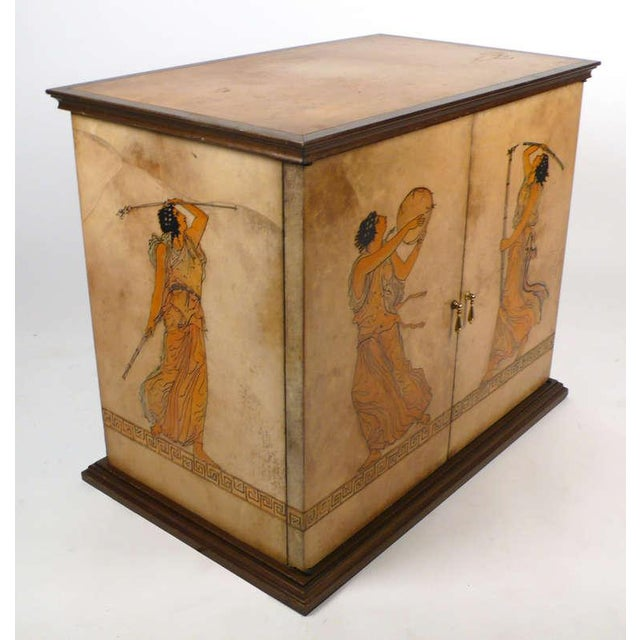 Handpainted vintage cabinet with a grecian theme wrapped in lacquered goatskin. Attributed to Aldo Tura.