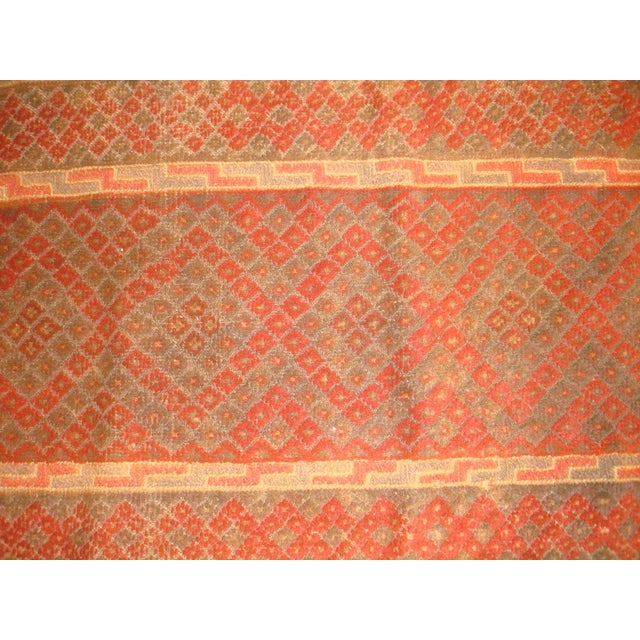 Add some ethnic elegance to your hallway with this fine Baluchestan runner rug. It has a plush wool pile, and was hand...