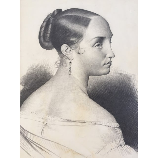Antique French pencil drawing of a woman. This original portrait comes from an artist's portfolio dated 1847. Presented in...