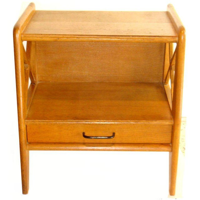Pair of oak side tables or nightstands designed by Jacques Adnet with one front drawer.s France. Circa 1950