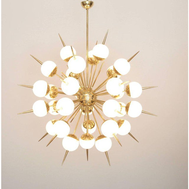 Exceptional huge Murano glass and brass Sputnik chandeliers attributed to Stilnovo. The chandeliers have a very impressing...