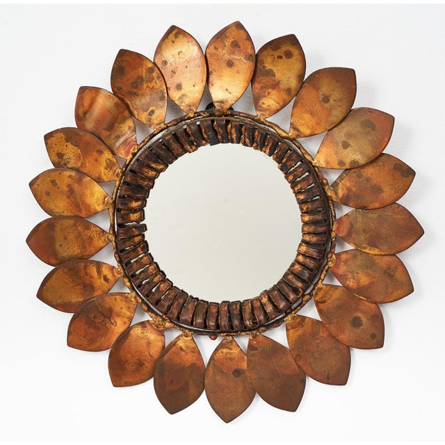 Hippie chic shear cut patinated metallic petals overlapped and welded in a circular array to form a charming abstract...